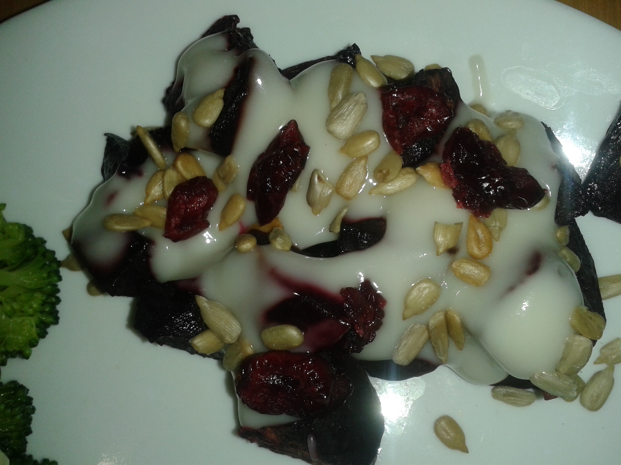 Baked Beets topped with Cultured Coconut Cream and Sunflower Seeds